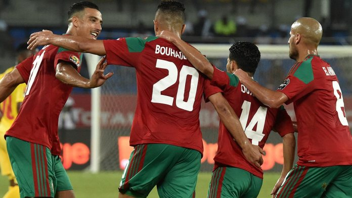 Morocco's forward Aziz Bouhaddouz (2nd-L) celebrates with teammates after scoring a goal during the 2017 Africa Cup of Nations group C football match between Morocco and Togo in Oyem on January 20, 2017.  ISSOUF SANOGO / AFP