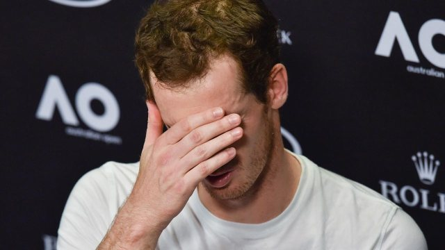 Britain's Andy Murray speaks during a press conference after his defeat against Germany's Mischa Zverev during their men's singles fourth round match on day seven of the Australian Open tennis tournament in Melbourne on January 22, 2017.  PAUL CROCK / AFP