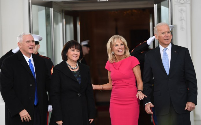 US Vice President Joe Biden(R)and his wife Jill(2nd-R) welcome Vice-president elect Mike Pence(L) and his wife Karen to the White House in Washington, DC January 20, 2017.  / AFP PHOTO / JIM WATSON