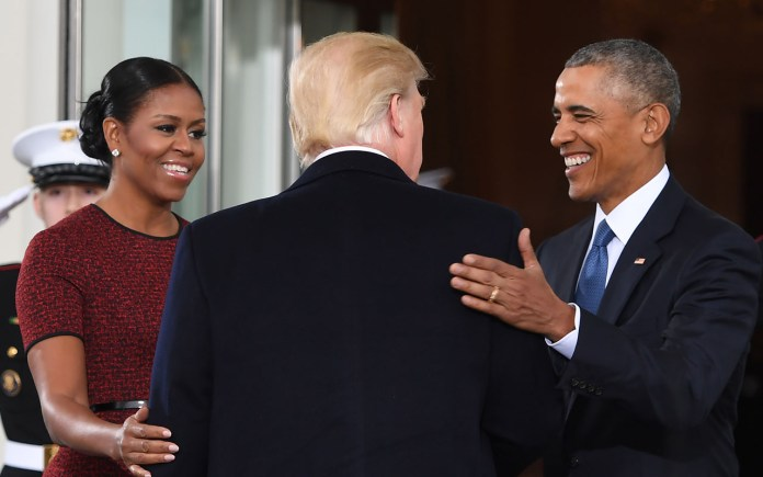 President-elect Donald Trump(C)is greeted by US President Barack Obama and First Lady Michelle Obama(L) as he arrives at the White House in Washington, DC January 20, 2017.  / AFP PHOTO / JIM WATSON