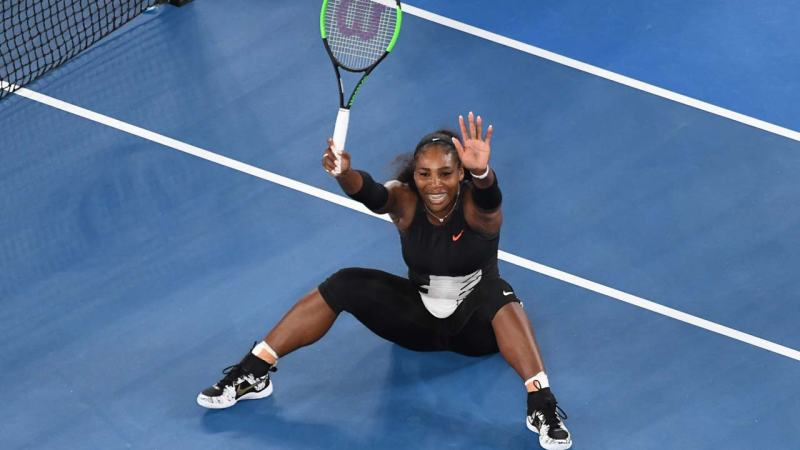 Serena Williams of the US reacts after beating Venus Williams of the US to win their women's singles final match on day 13 of the Australian Open tennis tournament in Melbourne on January 28, 2017.  SAEED KHAN / AFP