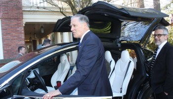 Look out, it's Gov. Jay Inslee behind the wheel of a semi-autonomous electric car