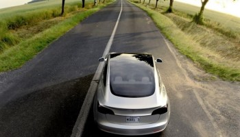 Tesla posts another loss but says it's on track to roll out Model 3 cars in July