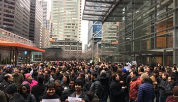 More than 1,200 Comcast employees are walking off their jobs to protest Trump immigration ban