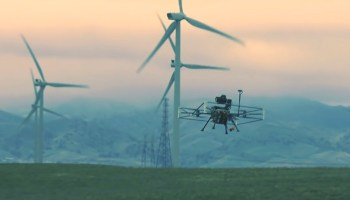 Drone inspecting wind turbines