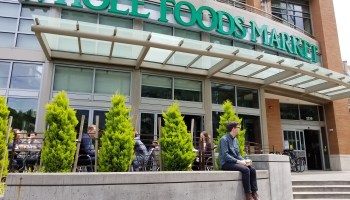 Shares of Whole Foods close above Amazon's price as speculation grows that outside bidder could challenge blockbuster deal
