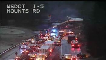 Amtrak train derails off bridge near Seattle, blocking all lanes of I-5