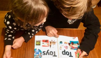 My kids sat in front of Amazon's first-ever printed toy catalog: 'Whoa! … Is everything in here free?'