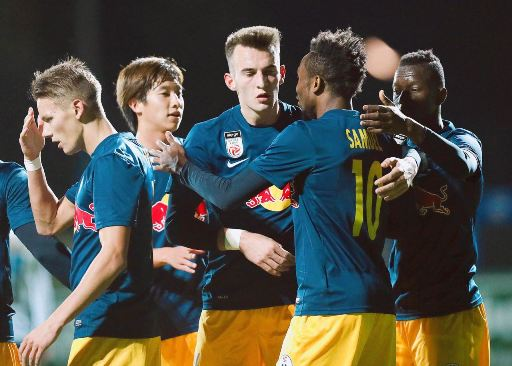 Samuel Tetteh celebrating with his FC Liefering teammates.
