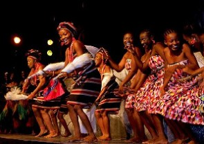 African Women in their local attires dancing during a stage performance to entertain their guests