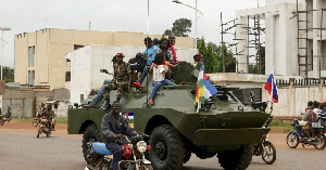 A photograph  of Military men in an amour vehicle