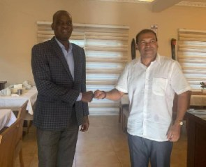 Mr Haruna Iddrisu and Mr Sugandh Rajaram exchanging greetings