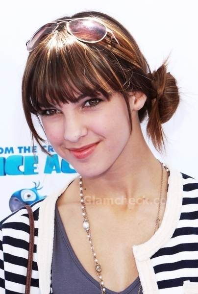 Denyse Tontz sports bangs with side knot at Rio LA Premiere