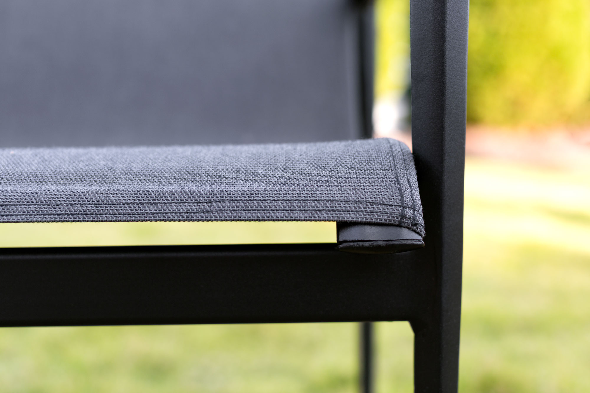 outdoor chair fabric cream upholstered dining chairs uk sunbrella sling detailing of made into an
