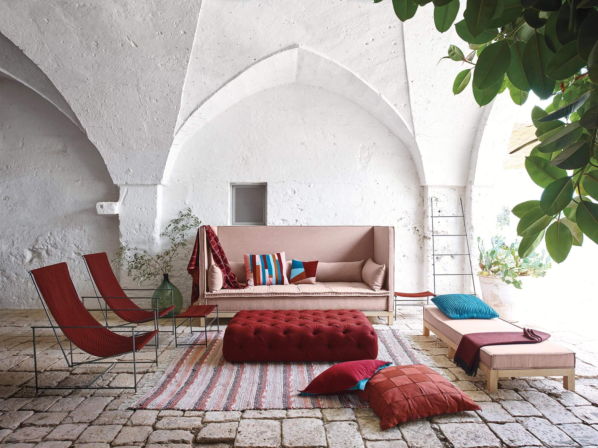 sofa fabric cleaner uk vibe magazine fabrics for the home indoor outdoor sunbrella a living room with large chairs and tufted ottoman in hues browse how to clean
