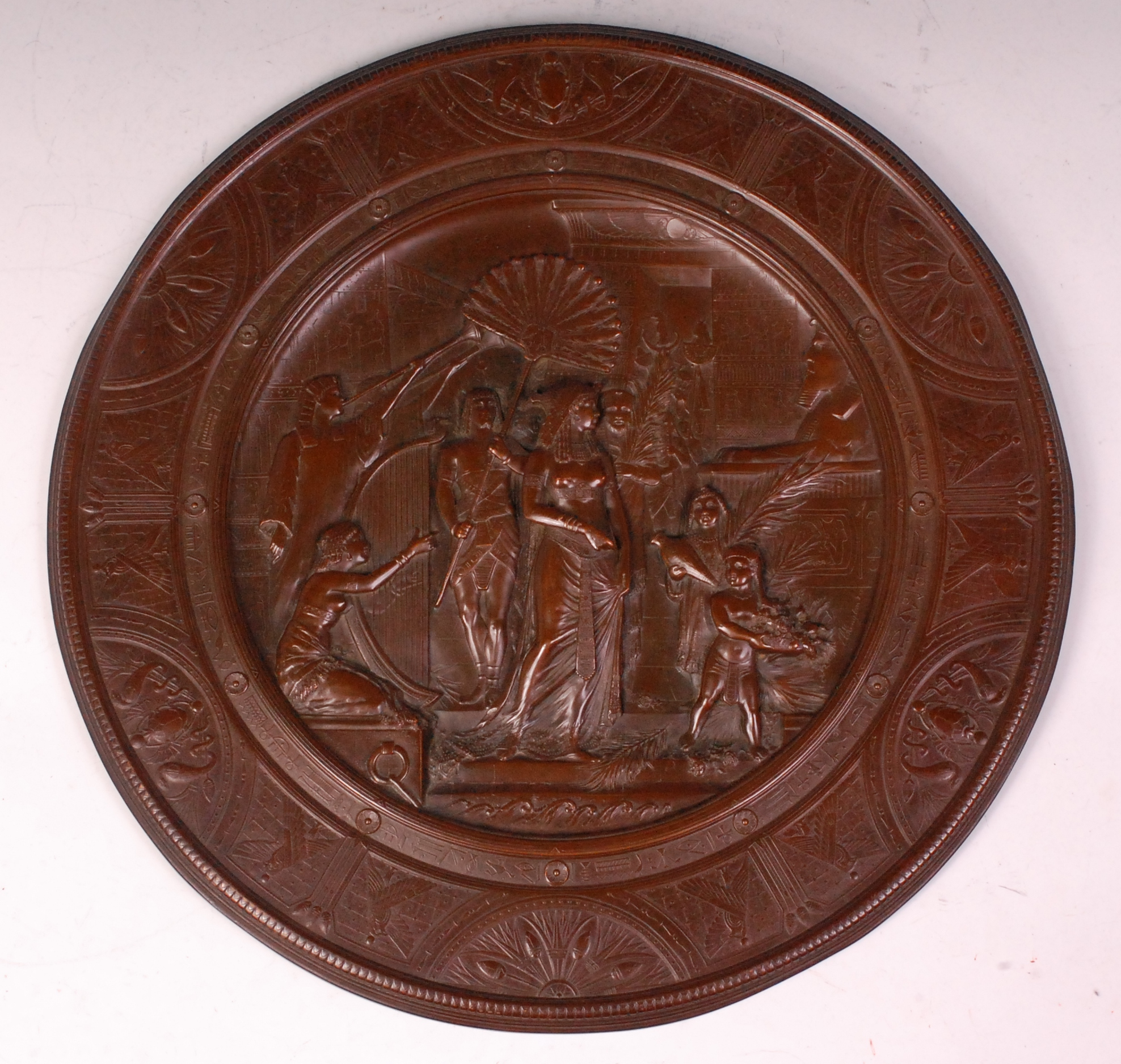 Thomas Spall for Elkington & Co - A late 19th century heavily embossed copper circular wall plaqu