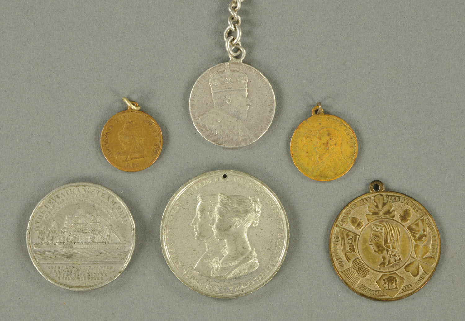 A Leviathan steamship medallion, and five others.