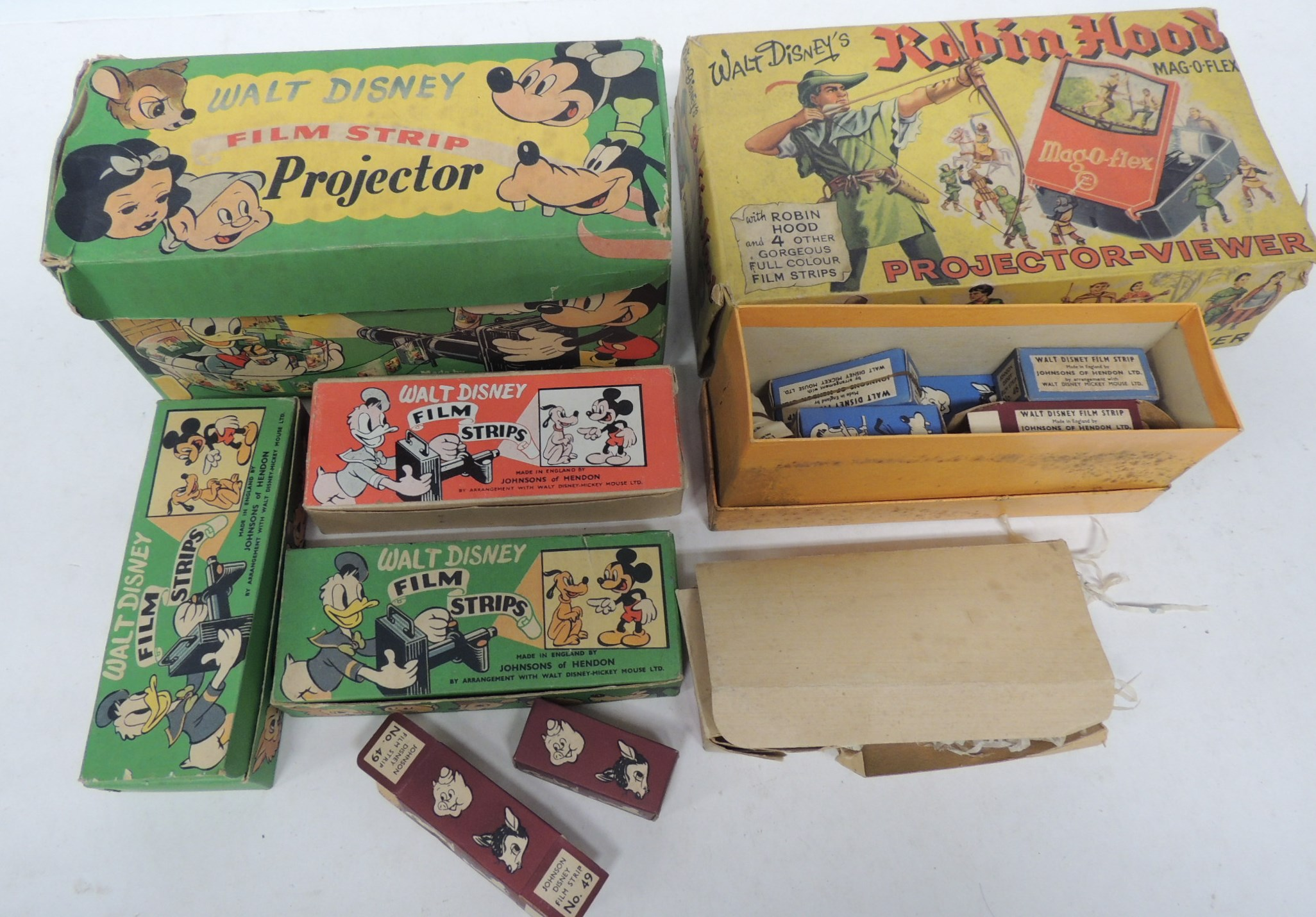 A Walt Disney Film Strip Projector by Johnsons of Hendon in original box and together with two bo