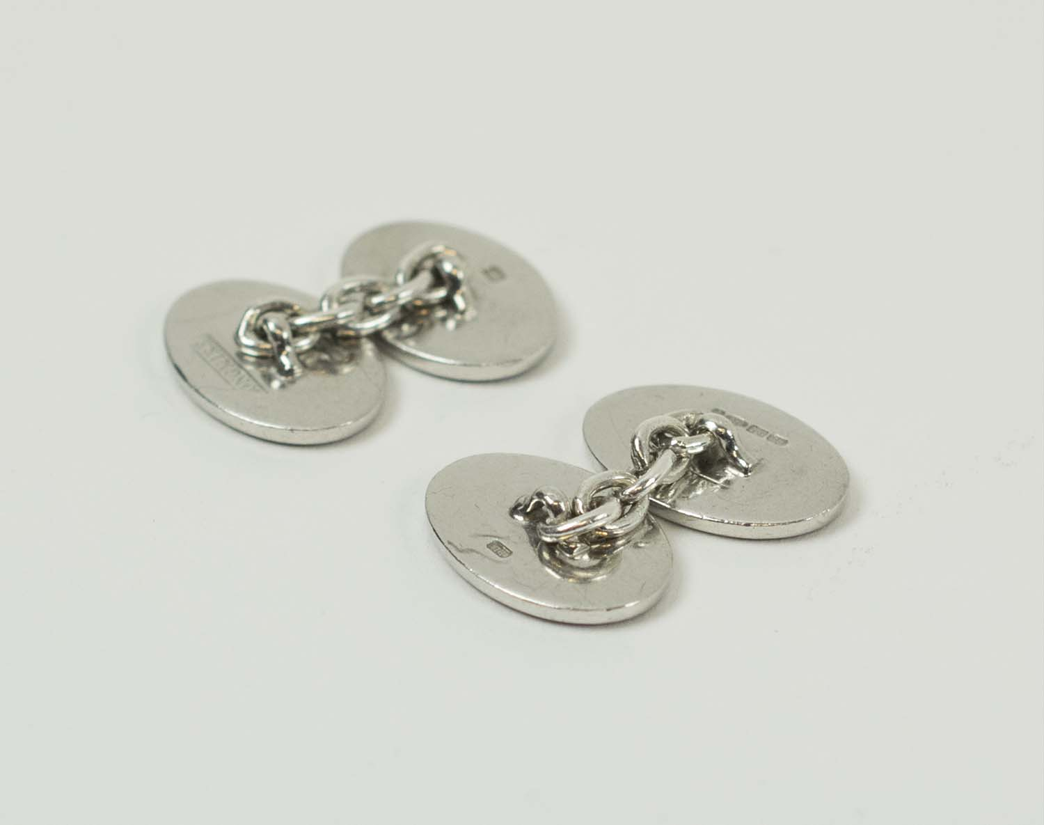 PAIR OF LONGMIRE STERLING SILVER AND COLOURED ENAMEL CUFFLINKS. (2)