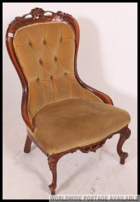 A Victorian style mahogany spoon back nursing chair with ...