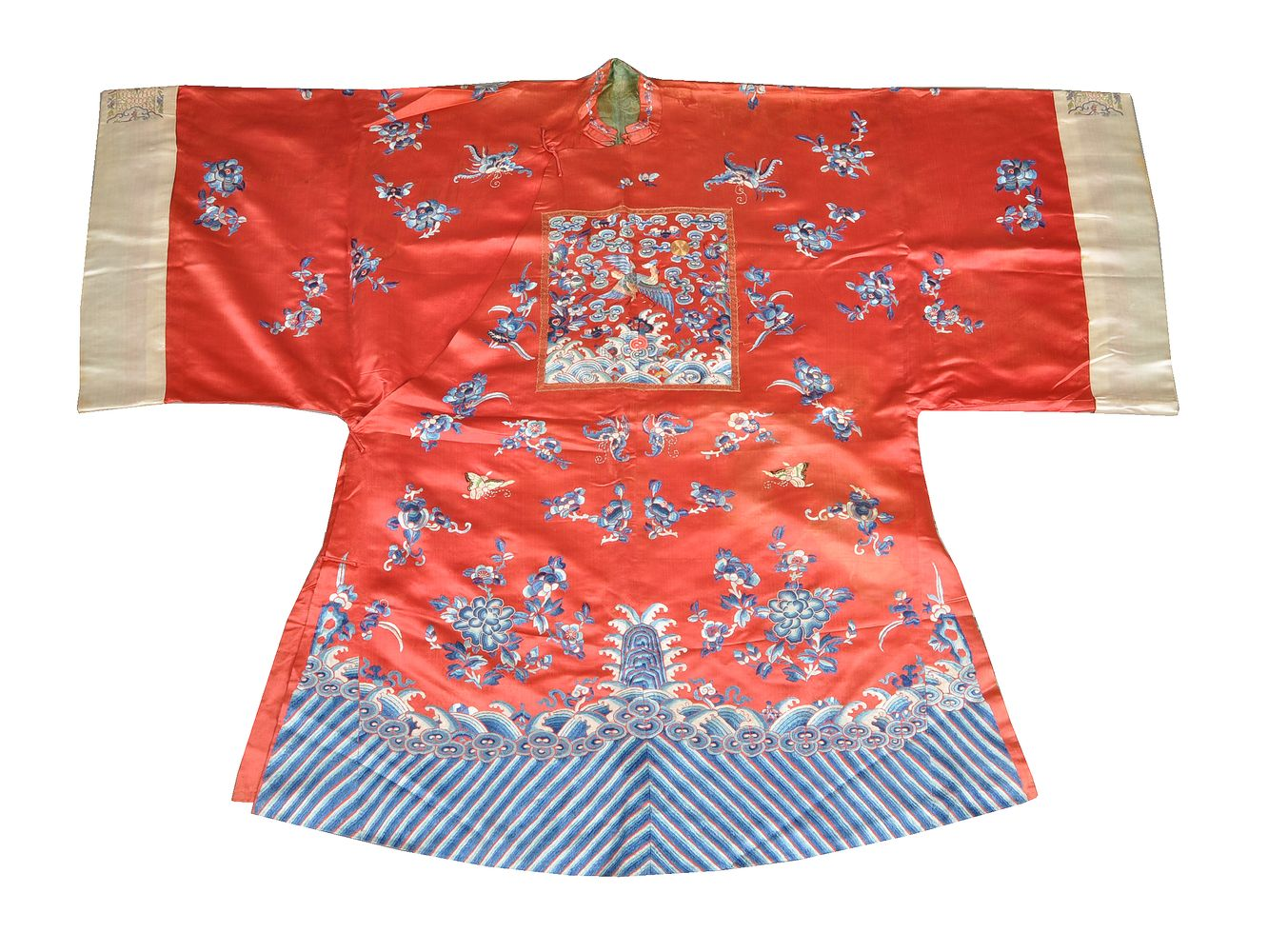 A Chinese red silk lady's semi-formal robe. Qing Dynasty. 19th century. embroidered with a 5th ra