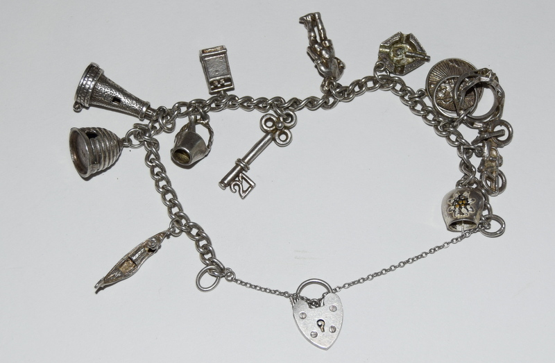 Silver charm bracelet and 12 charms