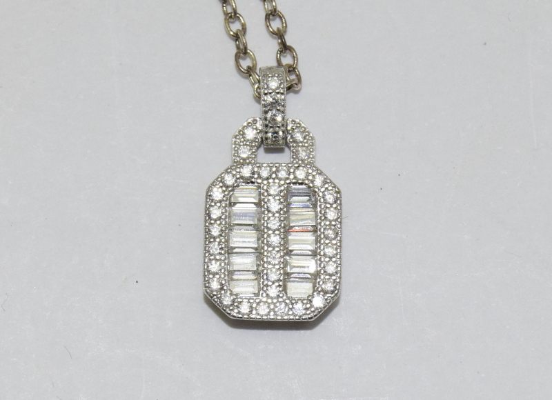 a silver and cz pendant necklace on silver chain