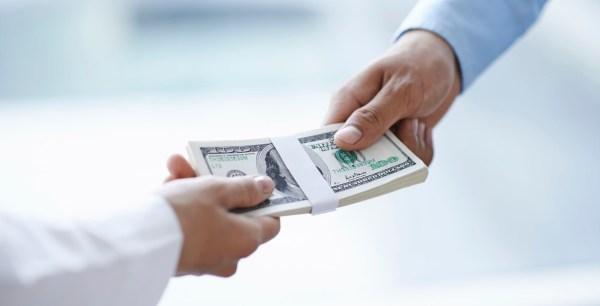 Pics of People Handing Over Money