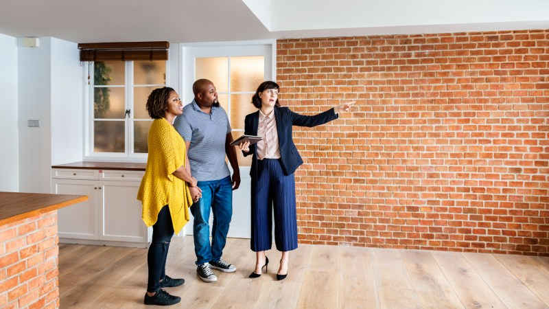 Property real estate manager showing tenants a new home