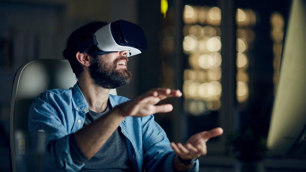 Man testing new app via VR device.