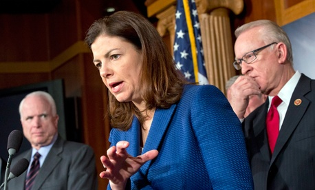 """Sen. Kelly Ayotte, R-N.H., center, responds to a reporter's question with House Armed Services Committee Chairman Howard """"Buck"""" McKeon, R-Calif., right, and Sen. John McCain, R-Ariz."""
