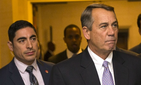 Outgoing House Speaker John Boehner (right) arrives at a meeting to nominate candidates for his replacement.