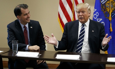 Wisconsin Gov. Scott Walker (left) joins Donald Trump at a meeting with small business leaders during the presidential campaign.