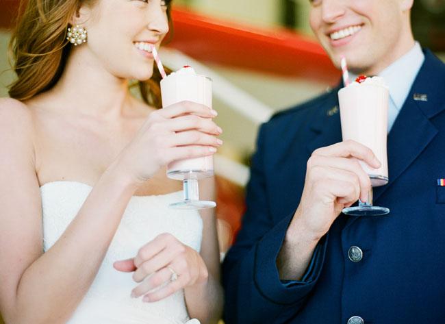 bride and groom drinking milkshakes