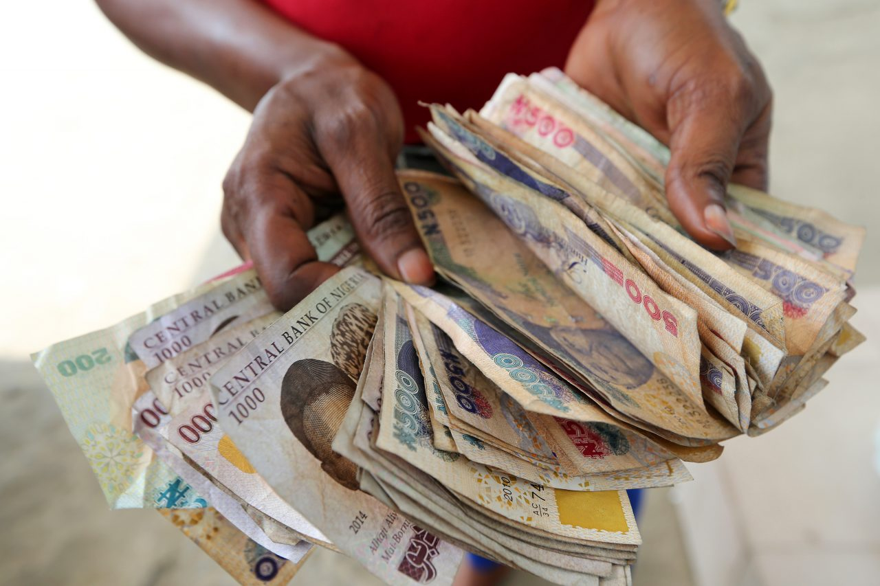 Naira notes: Photographer: George Osodi/Bloomberg via Getty Images