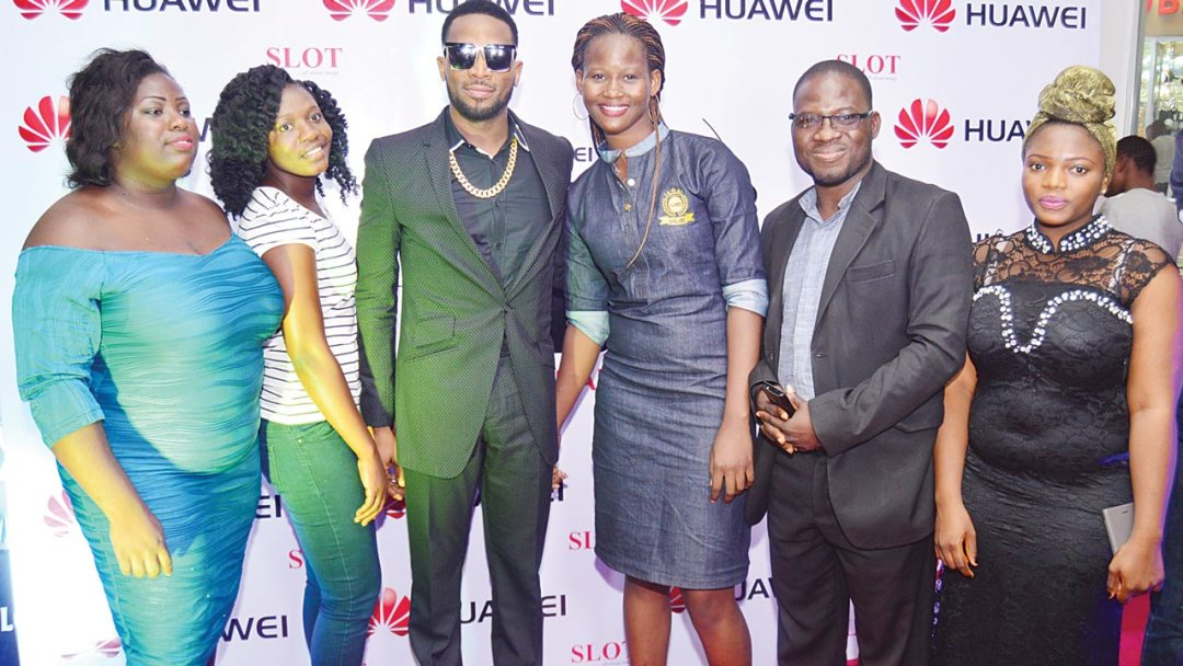 From left Love Akinlabi, Thatcher Okuegha, Maureen Orebanjo, Saka Abiola, and Saka Fayidat, all winners of the Huawei Share A Date competition, with music superstar D'banj, at the Huawei Share A Date with Dbanj event held at Silverbird Cinemas Ikeja recently.