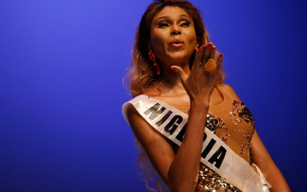 Miss Nigeria Miss saHHara (L) blows a kiss to the audience during the Miss Trans Star International beauty pageant in Cornella de Llobregat on September 18, 2016. / AFP PHOTO / PAU BARRENA