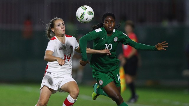 Emma Rose Regan of Canada tries to tackle Chinaza Love Uchendu of Nigeria during the FIFA U-20 Women's World Cup, Group B match between Nigeria and Canada at Bava Park on November 16, 2016 in Port Moresby, Papua New Guinea. PHOTO: Ian Walton - FIFA/FIFA via Getty Images