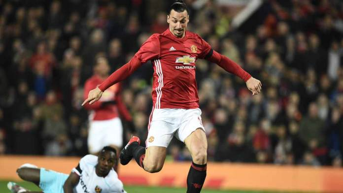 Manchester United's Swedish striker Zlatan Ibrahimovic scores his team's first goal during the EFL (English Football League) Cup quarter-final football match between Manchester United and West Ham United at Old Trafford in Manchester, north west England, on November 30, 2016.  Oli SCARFF / AFP