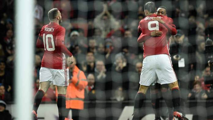 Manchester United's French striker Anthony Martial (R) celebrates scoring his team's second goal with Manchester United's Swedish striker Zlatan Ibrahimovic (C) and Manchester United's English striker Wayne Rooney during the EFL (English Football League) Cup quarter-final football match between Manchester United and West Ham United at Old Trafford in Manchester, north west England, on November 30, 2016.  Oli SCARFF / AFP