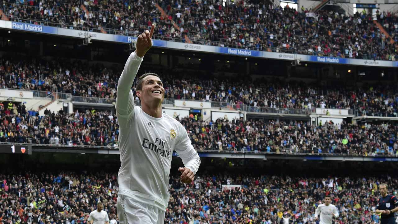 (FILES) This file photo taken on May 8, 2016 shows Real Madrid's Portuguese forward Cristiano Ronaldo celebrates after scoring a goal during the Spanish league football match Real Madrid CF vs Valencia CF at the Santiago Bernabeu stadium in Madrid. Cristiano Ronaldo won his fourth Ballon d'Or on December 12, 2016. JAVIER SORIANO / AFP