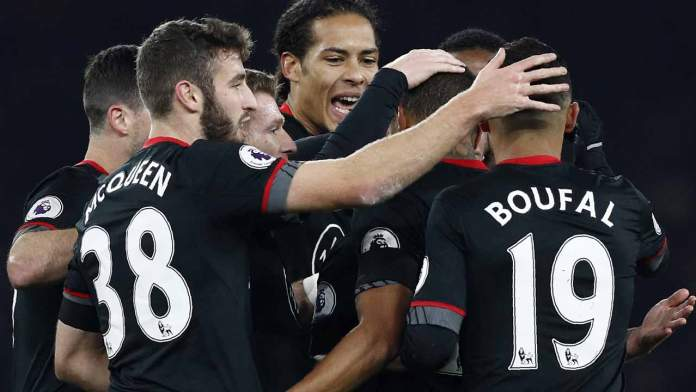 Southampton's Dutch defender Virgil van Dijk (C) and teammates congratulate Southampton's Dutch midfielder Jordy Clasie after Clasie scored his team's first goal during the EFL (English Football League) Cup quarter-final football match between Arsenal and Southampton at the Emirates Stadium in London on November 30, 2016.  Adrian DENNIS / AFP