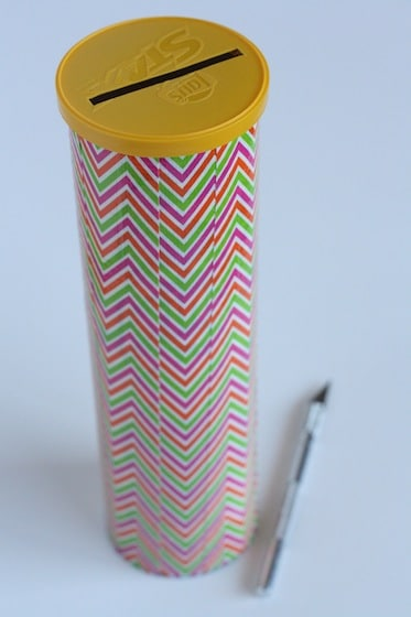 decorated pringles can and craft knife
