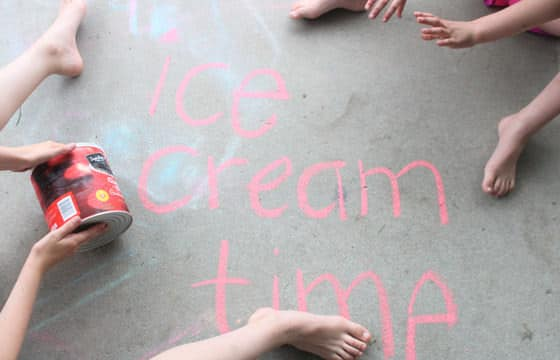kids Rolling a tin to make ice cream