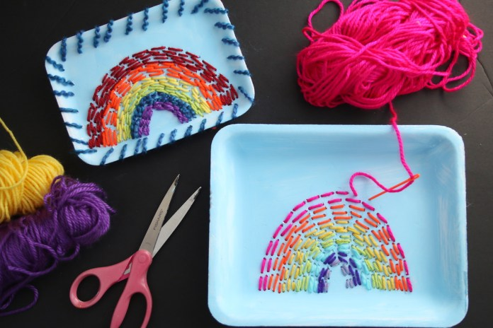 2 finished rainbow crafts, scissors, yarn