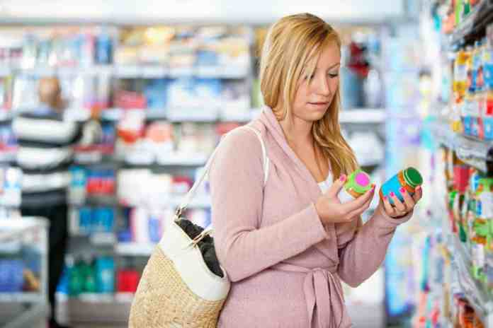 Woman shopping for pills at a pharmacy.
