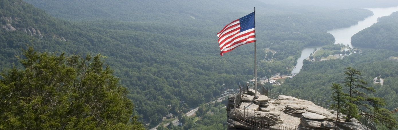 U.S. flag flew in at least one spot in North Carolina on statehood day, November 21, 2017. Photo at Chimney Rock State Park, outside of Asheville, North Carolina, near U.S. Highway 64/74A, on the Rocky Broad River.