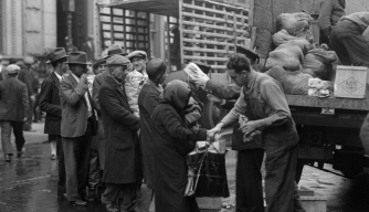policehandingfoodout  Soup Kitchens and Breadlines