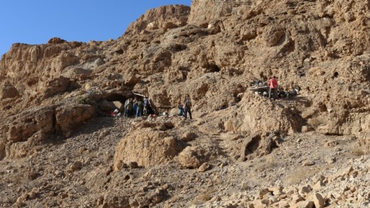 The fault cliff, with the cave entrance on the left