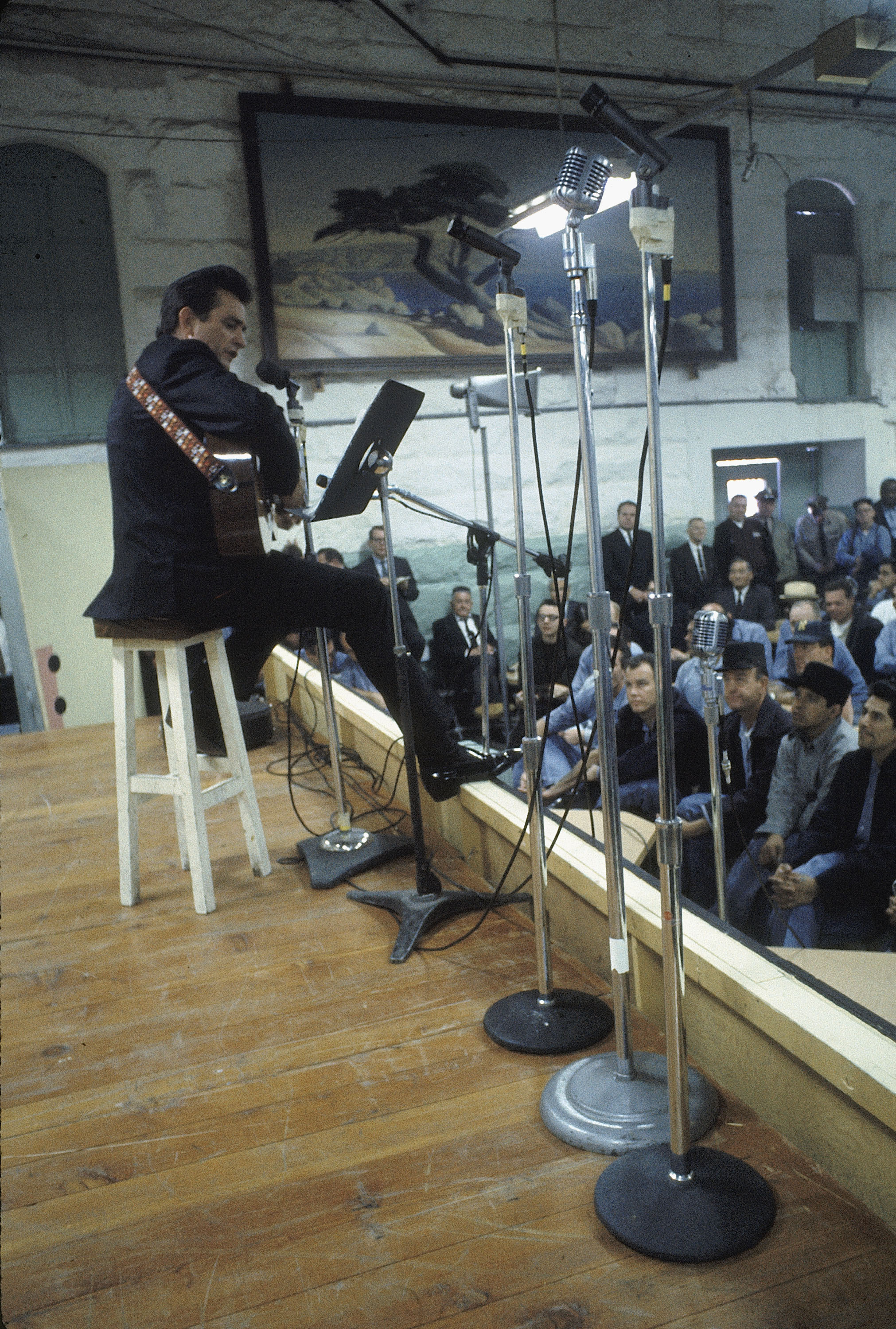 Country singer Johnny Cash performing for prisoners at the Folsom Prison in California on January 13, 1968. (Credit: Dan Poush/AP Photo)